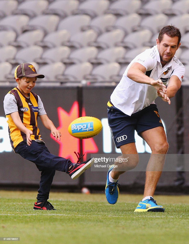 Luke Hodge of the Hawks has kick to kick with son Cooper Hodge before during the NAB CHallenge AFL match between the Hawthorn Hawks and the North Melbourne Kangaroos at Etihad Stadium on March 12, 2016 in Melbourne, Australia.