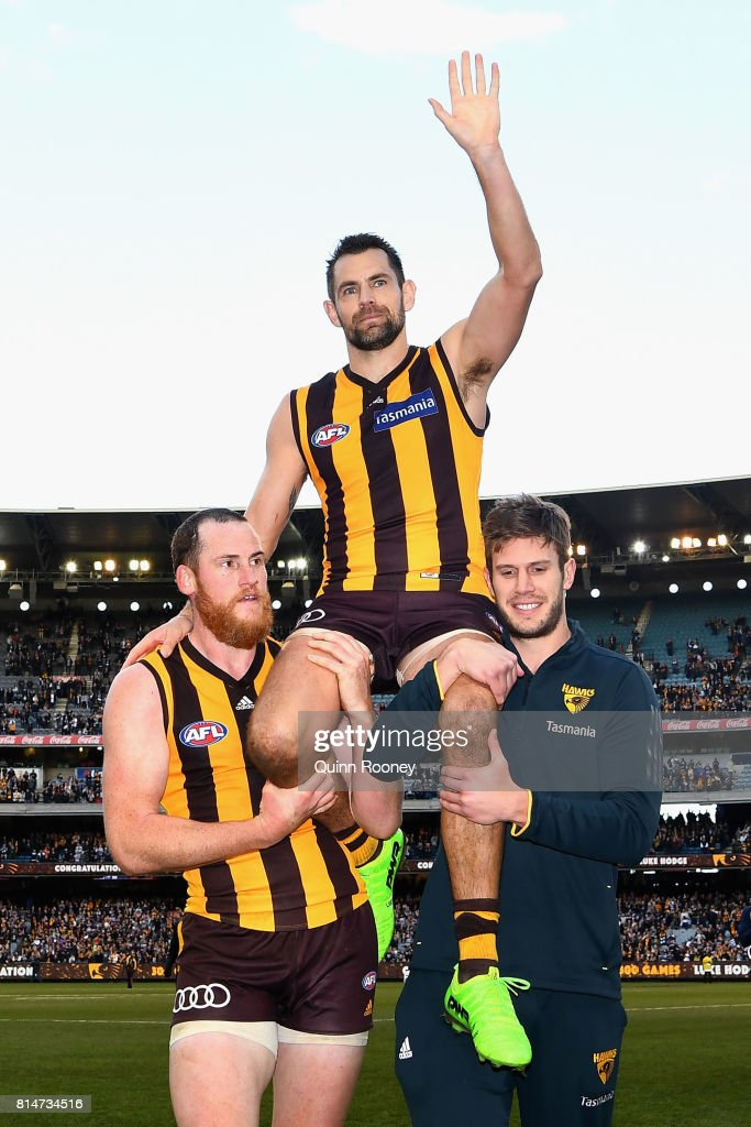 Luke Hodge of the Hawks is carried off in his 300th game during the round 17 AFL match between the Geelong Cats and the Hawthorn Hawks at Melbourne Cricket Ground on July 15, 2017 in Melbourne, Australia.
