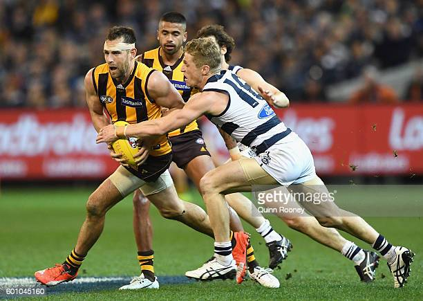 Luke Hodge of the Hawks is tackled by Scott Selwood of the Cats during the 2nd AFL Qualifying Final match between the Geelong Cats and the Hawthorn...