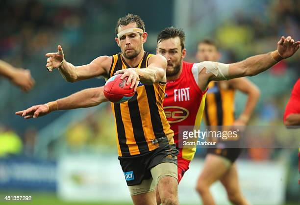 Luke Hodge of the Hawks kicks the ball during the round 15 AFL match between the Hawthorn Hawks and the Gold Coast Suns at Aurora Stadium on June 28...