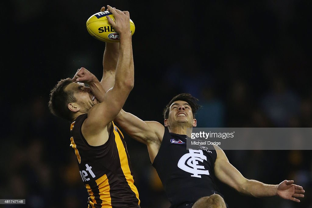 Luke Hodge of the Hawks marks the ball against Blaine Boekhorst of the Blues during the round 17 AFL match between the Carlton Blues and the Hawthorn Hawks at Etihad Stadium on July 24, 2015 in Melbourne, Australia.