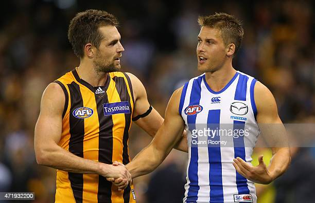 Luke Hodge of the Hawks shakes hands with Andrew Swallow of the Kangaroos after the game during the round five AFL match between the North Melbourne...