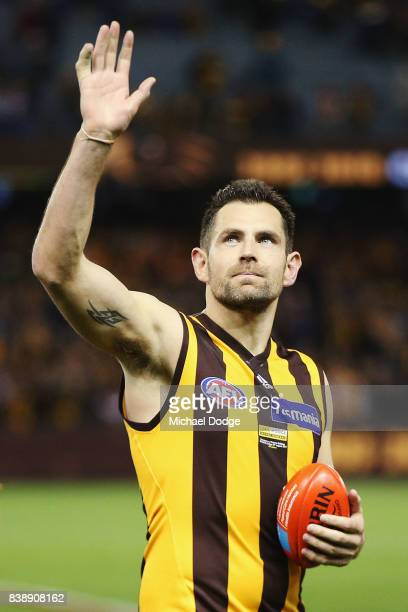 Luke Hodge of the Hawks waves to fans after his retirement match during round 23 AFL match between the Hawthorn Hawks and the Western Bulldogs at...