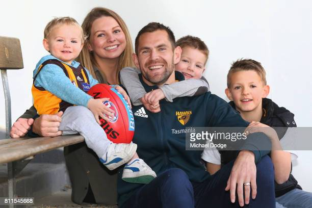 Luke Hodge poses with family after announcing his retirement on the eve of his 300th during a Hawthorn Hawks AFL press conference at Waverley Park on...