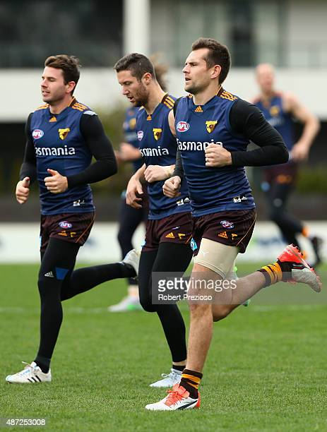 Luke Hodge runs with team-mates during a Hawthorn Hawks AFL training session at Waverley Park on September 8, 2015 in Melbourne, Australia.