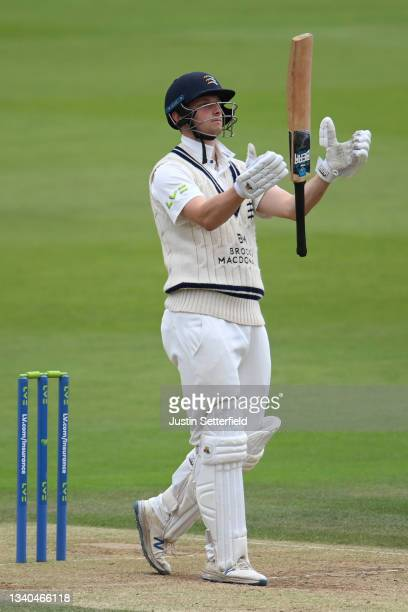 Luke Hollman of Middlesex reacts after playing and missing during the LV= Insurance County Championship match between Middlesex and Worcestershire at...