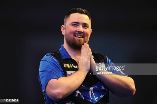 Luke Humphries of England celebrates winning his Second Round match against Jermaine Wattimena of The Netherlands during Day Two of the 2020 William...