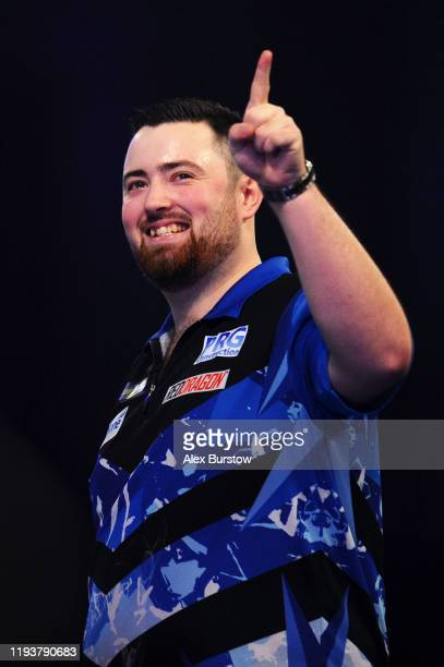 Luke Humphries of England celebrates winning in his First Round match against Devon Petersen of South Africa during Day One of the 2020 William Hill...