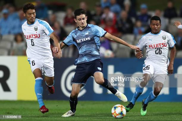 Luke Ivanovic of Sydney FC is challenged by Hidemasa Morita and Maguinho of Kawasaki Frontale during the AFC Asian Champions League match between...