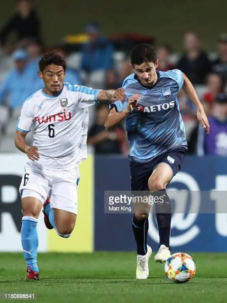 Luke Ivanovic of Sydney FC is challenged by Hidemasa Morita of Kawasaki Frontale during the AFC Asian Champions League match between Sydney FC and...