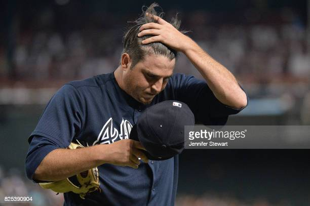 Luke Jackson of the Atlanta Braves reacts in the fourth inning of the MLB game against the Arizona Diamondbacks at Chase Field on July 26 2017 in...