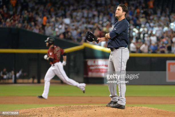 Luke Jackson of the Atlanta Braves stands on the mound as JD Martinez of the Arizona Diamondbacks rounds the bases on his tworun home run in the...
