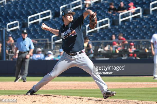 Luke Jackson of the Atlanta Braves throws the ball against the Washington Nationals during a spring training game at The Ballpark of the Palm Beaches...