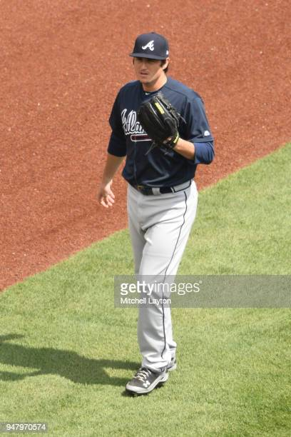 Luke Jackson of the Atlanta Braves warms up before a baseball game against the Washington Nationals at Nationals Park on April 11 2018 in Washington...