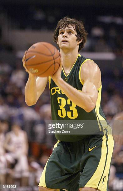 Luke Jackson of the Oregon Ducks shoots a free throw against the Stanford Cardinal in the Semifinals of the 2004 Pacific Life Pac10 Tournament at...
