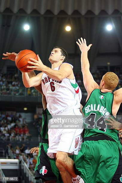Luke Jackson of the Toronto Raptors goes to the basket past Brian Scalabrine of the Boston Celtics during the NBA preseason game as part of the 2007...
