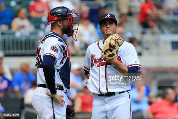Luke Jackson talks to Tyler Flowers of the Atlanta Braves after giving up a run during the eighth inning against the New York Mets at SunTrust Park...