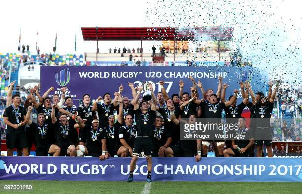 Luke Jacobson of New Zealand lifts the winners trophy and celebrates with his team after victory during the World Rugby U20 Championship final match...