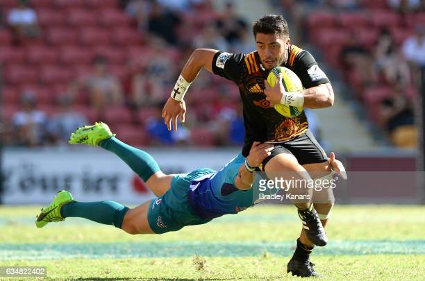 Luke Jacobson of the Chiefs breaks away from the defence during the Rugby Global Tens semifinal match between the Chiefs and Bulls at Suncorp Stadium...