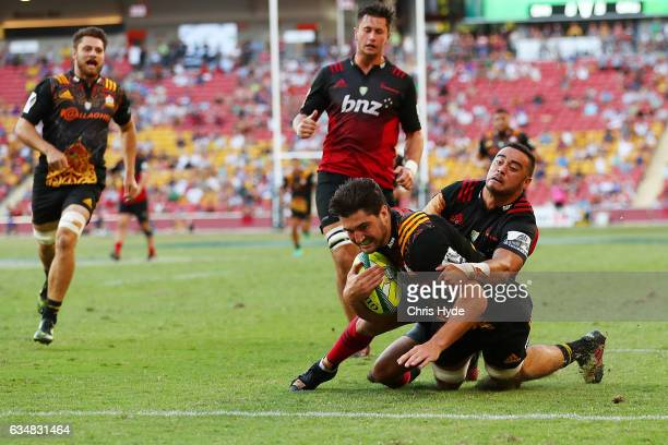 Luke Jacobson of the Chiefs make a break to score a try during the Rugby Global Tens Final match between Chiefs and Crusaders at Suncorp Stadium on...