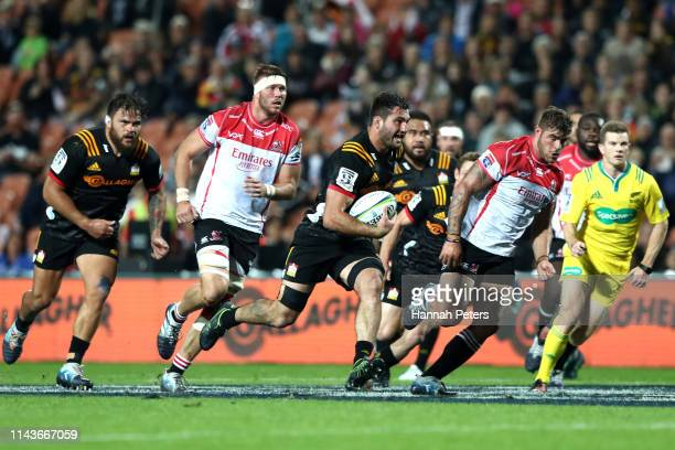 Luke Jacobson of the Chiefs makes a break during the round 10 Super Rugby match between the Chiefs and the Lions at FMG Stadium on April 19 2019 in...