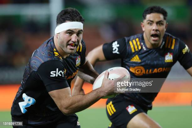 Luke Jacobson of the Chiefs makes a break during the round two Super Rugby Trans-Tasman match between the Chiefs and the ACT Brumbies at FMG Stadium...