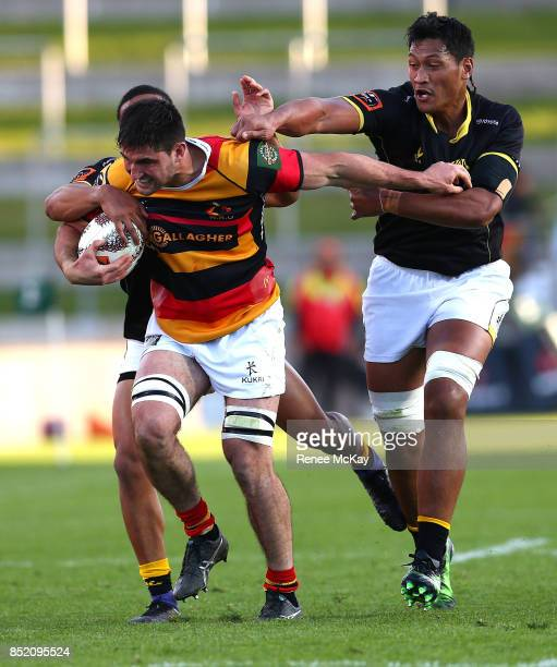 Luke Jacobson of Waikato fends off Sam Lousi of Wellington during the round six Mitre 10 Cup match between Waikato and Wellington at FMG Stadium on...