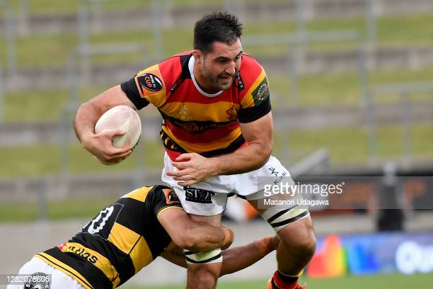 Luke Jacobson of Waikato is tackled during the round 7 Mitre 10 Cup match between Waikato and Taranaki at FMG Stadium on October 25 2020 in Hamilton...