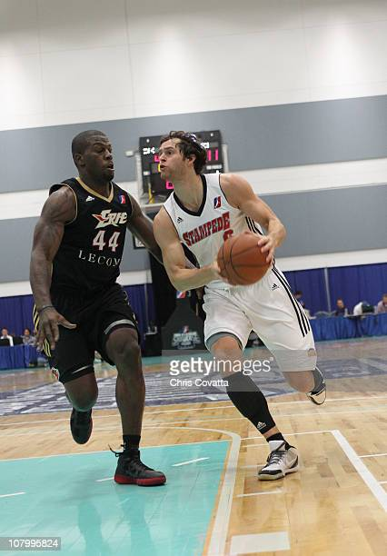 Luke Jakson of the Idaho Stampede drives the ball past Ivan Johnson of the Erie Bayhawks during the 2011 NBA DLeague Showcase on January 11 2011 at...