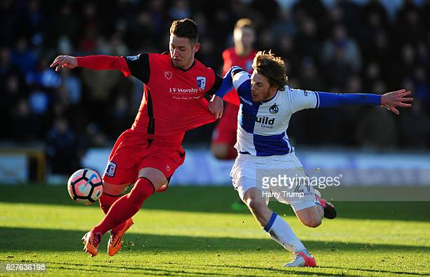 Luke James of Bristol Rovers is tackled by Shaun Beeley of Barrow FC during the Emirates FA Cup Second Round match between Bristol Rovers and Barrow...