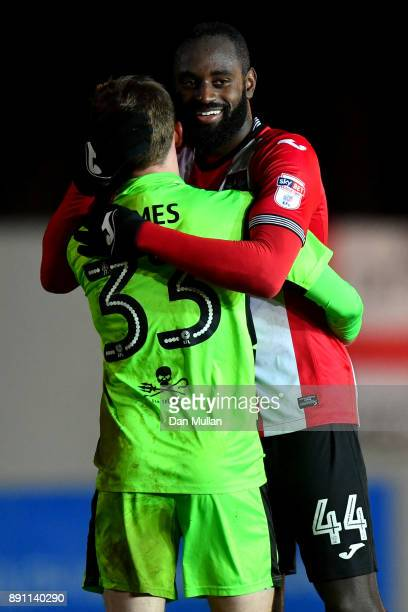 Luke James of Forest Green Rovers embraces Hiram Boateng of Exeter City after the Emirates FA Cup Second Round Replay between Exeter City and Forest...
