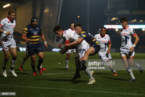 Luke James of Sale is held up by Will Butler of Worcester during the AngloWelsh Cup match between Worcester Warriors and Sale Sharks at Sixways...