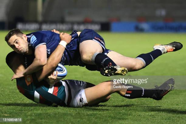 Luke James of Sale is tackled by Dan Kelly of Leicester during the Gallagher Premiership Rugby match between Sale Sharks and Leicester Tigers at AJ...
