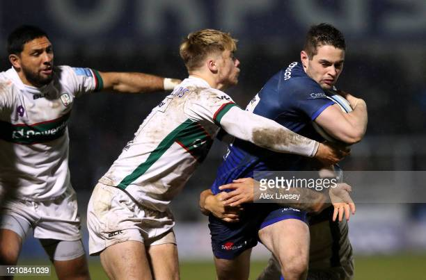 Luke James of Sale Sharks is tackled by Ollie Hassell Collins and Terrance Hepetema of London Irish during the Gallagher Premiership Rugby match...