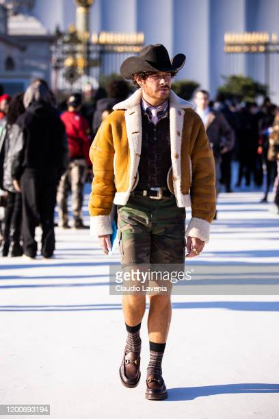 Luke Jefferson Day, wearing a checked shirt, brown polo shirt, tan jacket, military print shorts, black hat and brown loafers, is seen outside the...