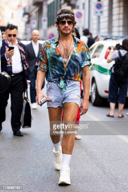 Luke Jefferson Day wearing a printed shirt light blue denim shorts and white Alexander McQueen sneakers is seen outside Giorgio Armani show during...