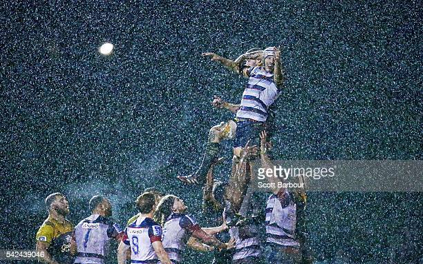 Luke Jones of the Rebels competes for the ball in a lineout in torrential rain during the Super Rugby Exhibition match between the Rebels and the...