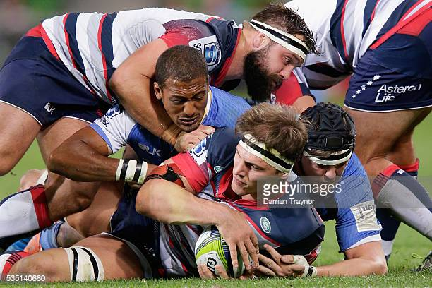 Luke Jones of the Rebels protects the ball during the round 14 Super Rugby match between the Rebels and the Force at AAMI Park on May 29 2016 in...