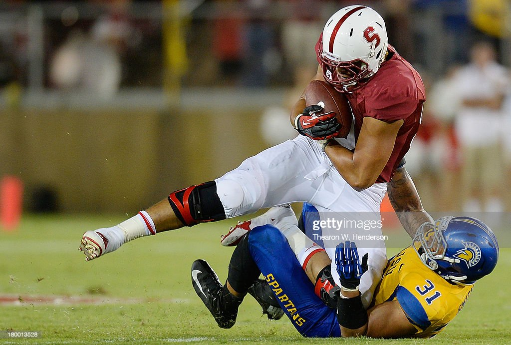 Luke Kaumatule #99 of the Stanford Cardinal gets tackled by Keith Smith #31 of the San Jose State Spartans during the third quarter at Stanford Stadium on September 7, 2013 in Palo Alto, California. The Cardinals won the game 34-13.