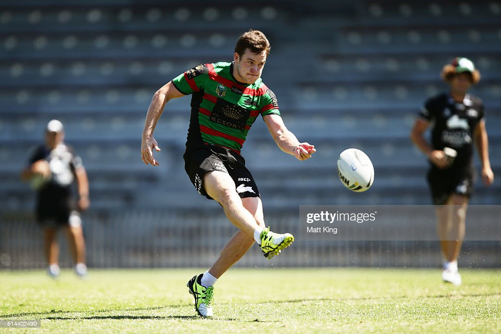 Luke Keary kicks during a South Sydney Rabbitohs NRL training session at Redfern Oval on March 9, 2016 in Sydney, Australia.