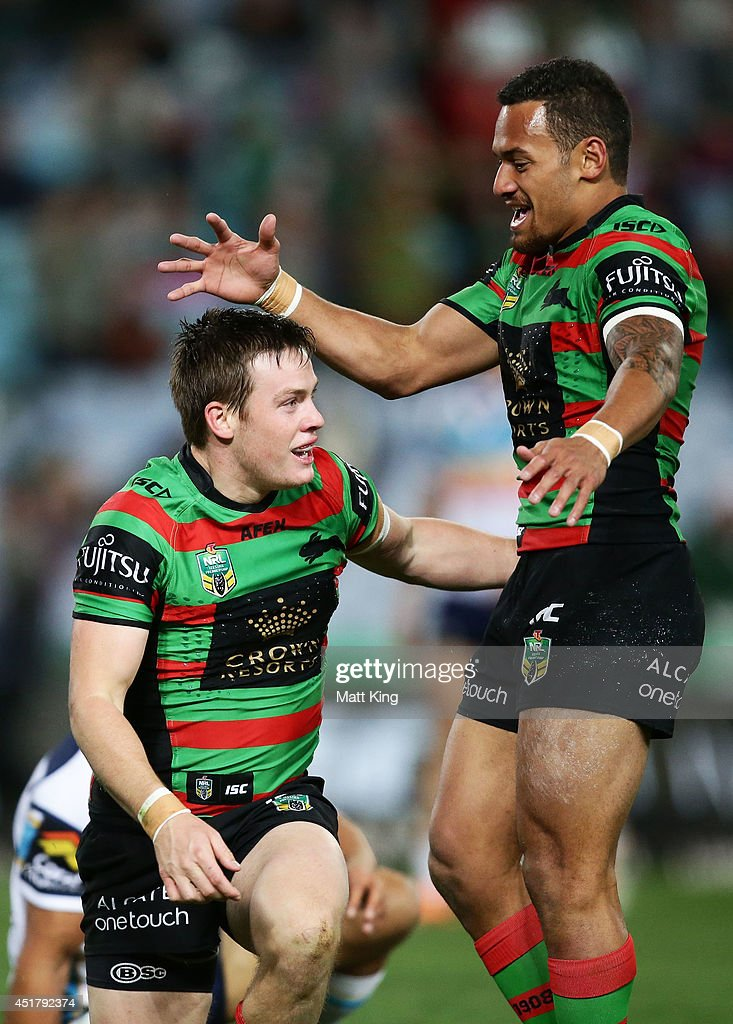 Luke Keary (L) of the Rabbitohs celebrates with Apisai Koroisau (R) after scoring a try during the round 17 NRL match between the South Sydney Rabbitohs and the Gold Coast Titans at ANZ Stadium on July 7, 2014 in Sydney, Australia.