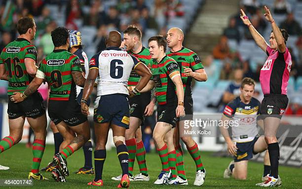 Luke Keary of the Rabbitohs celebrates with his team as claims a try only to have it ruled a no try by the video referee during the round 24 NRL...
