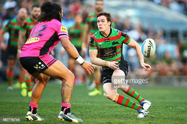 Luke Keary of the Rabbitohs passes during the round 21 NRL match between the South Sydney Rabbitohs and the Penrith Panthers at ANZ Stadium on August...