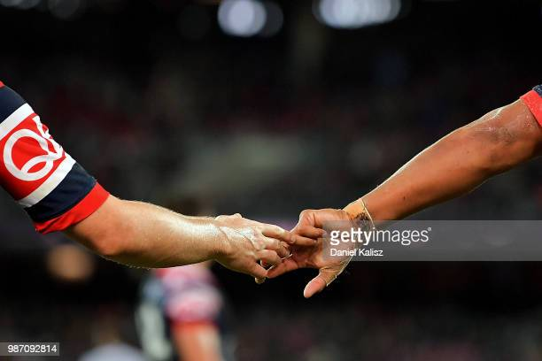 Luke Keary of the Roosters and Latrell Mitchell of the Roosters react during the round 16 NRL match between the Sydney Roosters and the Melbourne...