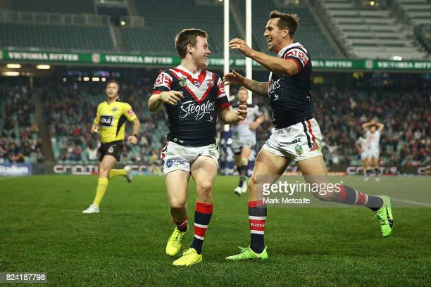 Luke Keary of the Roosters celebrates scoring a try with team mate Mitchell Pearce during the round 21 NRL match between the Sydney Roosters and the...