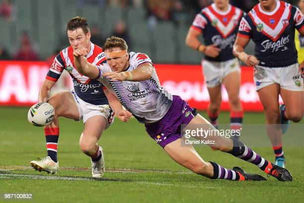 Luke Keary of the Roosters controls the ball during the round 16 NRL match between the Sydney Roosters and the Melbourne Storm at Adelaide Oval on...