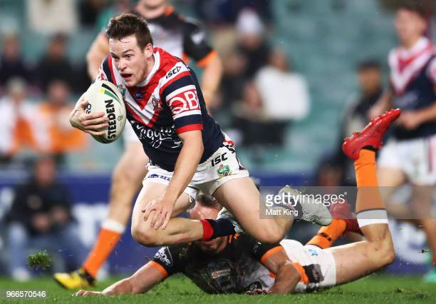 Luke Keary of the Roosters is ankle tapped by Josh Reynolds of the Tigers during the round 13 NRL match between the Sydney Roosters and the Wests...