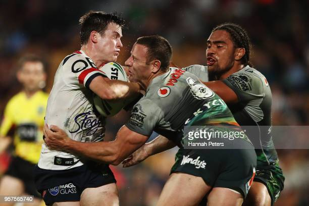 Luke Keary of the Roosters is tackled by Blake Green of the Warriors during the round 10 NRL match between the New Zealand Warriors and the Sydney...
