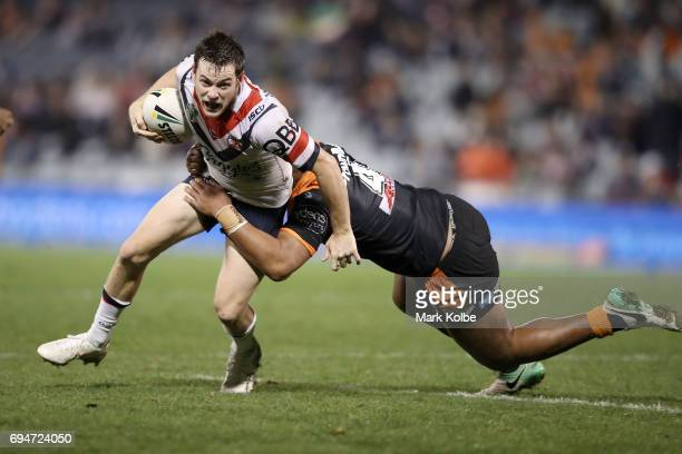 Luke Keary of the Roosters is tackled by Moses Suli of the Tigers during the round 14 NRL match between between the Wests Tigers and the Sydney...