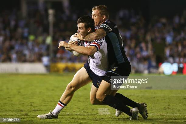 Luke Keary of the Roosters is tackled by Trent Hodkinson of the Sharks during the round five NRL match between the Cronulla Sharks and the Sydney...